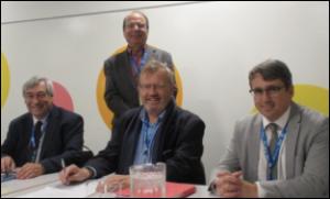 De g. à d. M. Denis Racine, M. Robert Trudel, animateur, M. Marc Martin, M. Denis Desgagné.